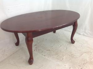 Oval mahogany effect coffee table