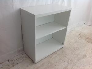Small_white_ikea_bookcase_with_2_small_adjustable_feet_